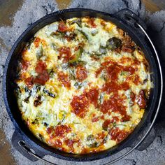 Use a Dutch oven to make lasagna over the campfire! Simply layer the bottom of the dish with lasagna sheets, then put all your other ingredients on top. An easy campfire recipe!