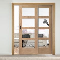 Easi-Slide OP3 Oak Shaker 4 Pane Sliding Door System in Four Size Widths with Clear Glass and sliding track frame. #modernslidingdoors #slidingdoors #oakglazedslidingdoors