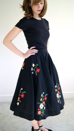 Description:  Gorgeous black high waist circle skirt hand crafted and hand embroidered with colorful raffia. Beautiful floral designs, large