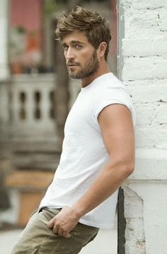 A fitted white tee is probably the hottest thing a man can wear..... I do like a white T!