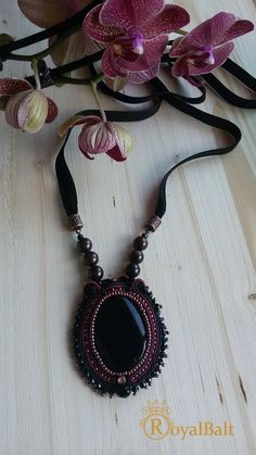 Beautiful handmade soutache pendant. Materials: soutache ribbon, in center - black agate, garnet stone, crystal with Swarovski elements. Strips length – 45 cm. and more. Pendant length – 6 cm. Back - natural leather.