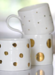 Gold Polka dot mugs. Not what this pin links to BUT I could use a gold sharpie on ceramic mugs and put them in the oven...
