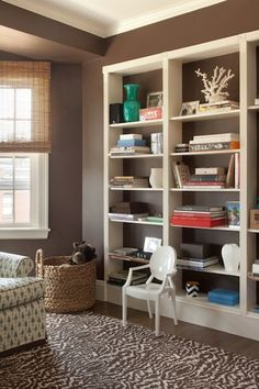 Love the open bookcase w/wall color behind it. Would putting a different pattern/accent color behind the bookcase make room look smaller? Also like the warm color palette Bookshelf Styling, Bookcase Shelves, Bookcases, Office Shelving, Open Bookcase, Open Shelves, Ideas Hogar, My Living Room, Home Organization