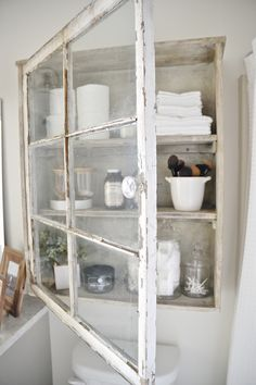 DIY window bathroom cabinet - So easy & functional! A great statement piece in any room.