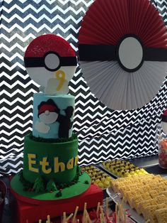 POKEMON PARTY for a 9 year old boy was a success!! PokeBall made out of a giant paper pinwheel, pikachu's made out of Easter bunny Peeps and lots of other yum mines made up this dessert table / candy station!
