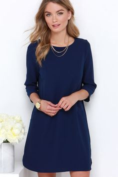 With strappy sandals and a sun hat, or heels and a blazer, there's infinite styling possibilities with the Jack by BB Dakota Dee Navy Blue Shift Dress! Medium-weight, textured woven poly-spandex sweeps across a rounded neckline, into modest three-quarter sleeves. Princess seams fall down down the shift bodice to meet two diagonal welt pockets, and skirt with rounded hems. Keyhole with top button at back. Unlined. 98% Polyester, 2% Spandex. Hand Wash Cold or Dry Clean. Imported.