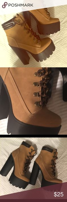CUTE PLATFORM BOOTS💋💋💋💋💋 Cute and stylish timberland look a like boot with a nice platform heel that makes this boot so unique and stylish Heel is 6 inches on flaw as seen in photo two scuff marks very light not noticeable when worn Qupid Shoes Platforms