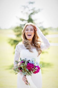 Happy bride laughs during this candid moment on her wedding day at Saratoga…