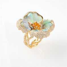 Signature Flower Ring set in 18K Yellow Gold with hand-carved solid White Opal flower petals and Mandarin Garnet center, surrounded by Diamonds