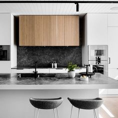The Bell Street #house renovated by @technearchitects was redesigned based on the owners' focus for entertaining, and features a monochromatic #kitchen with moody hues and textural finishes.  Photo by @blachford, styling by @lucybock