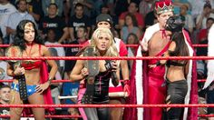 Mickie James, in the back Trish Stratua and Jerry Lawler and Candice Michelle
