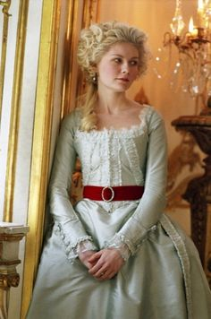 Marie Antoinette. This is my absolute favorite dress, I love the tealish blue and the red velvet sash. -Ellsie Margaux
