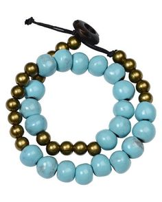 Trades of Hope - Revel in the pretty blue and gold beads in this wrap bracelet.    Haiti had this centuries worst natural disaster and is home to almost 500,000 orphans. The majority of the orphans have not been orphaned by prenatal deaths,or natural disasters, but by parents who gave them up simply because they could not feed them. Material: Clay, wooden button  Color: blue, gold