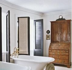 Wooden shutters in Washington, DC-based Darryl Carter's townhouse, via Point Click Home. | Remodelista