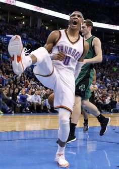 Oklahoma City's Russell Westbrook (0) celebrates a dunk during the NBA basketball game between the Oklahoma City Thunder and the Boston Celtics at the Chesapeake Energy Arena in Oklahoma City, Wednesday, March 18, 2015. Photo by Sarah Phipps, The Oklahoman
