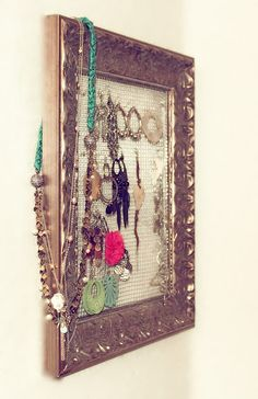 I'm a jewelry hoarder. Totally need to do this...