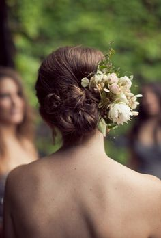 Brides.com: The Best Wedding Hairstyles on Pinterest. An Intricate Low Bun with Flowers. This intricate bun is just the thing for an outdoor ceremony. We love how the shape of the bun mirrors a bouquet and how the flowers are perfectly placed on the side. For a complete garden-party look, pair this style with a soft lace or floral-appliquéd gown. (If you want to show off a long, swanlike neck and collarbone, go for a strapless neckline like this gorgeous bride did.)     See more bohemian ...