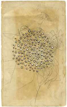 Olivia Jeffries - burn holes on found paper