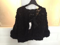 Nina Ricci black lace detailed top with open back and bow detail. Ruffled sleeve-ends. SS2012 collection French Size 38 OP 1800EUR