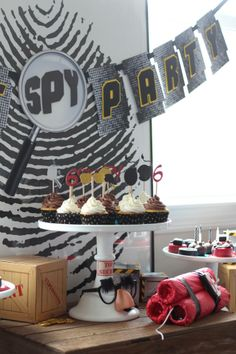 Cupcakes for a SPY Birthday Party. Custom glitter cupcake toppers by @Made by a Princess Parties in Style