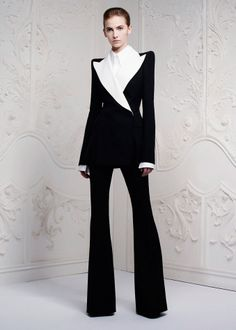 Alexander McQueen, Fall 2013  A sleek and sexy pantsuit with a fitted torso and elongated legs that could have been tailored on Saville Row.