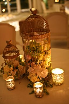 Vintage elegant birdcages with silver twinkle hurricane lanterns, beautiful marquee wedding