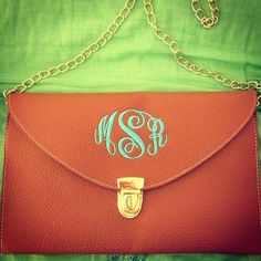monogram marley lilly clutch just purchased! brown and yellow! <3