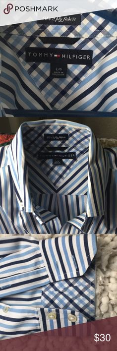 Tommy Hilfiger men's long sleeved stripe shirt This is a BEAUTIFUL Hilfiger shirt in the softest , 80's 2ply cotton .      It feels so good to the touch , you won't be able to keep your hands off it .   Besides , it looks absolutely irresistible on .     The stripes are light blue & dark blue on white , though it's really hard to tell if the dark blue is actually black . Bias detail in collar , cuffs, side edges.     Excellent used condition  No signs of wear no tears or stains, all buttons…