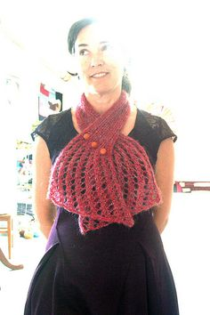 My first ever knitting pattern was inspired by the new dress I bought at Anthropologie last week and a half skein of vintage yarn from the thrift store. It was made as a button up neck wrap (below)...
