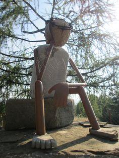 sacred figure made of granite and steel