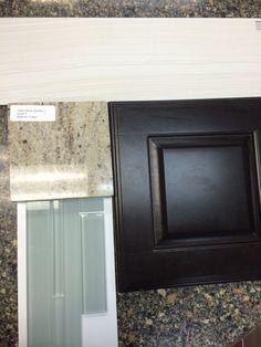 cabinets, main floor tile, glass back splash, granite. I think this granite is too beige.