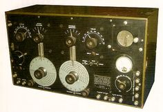 The U.S. Army Signal Corps BC-131 version of the SE-1420C. This example has the olive-drab painted wooden case. This is an AMRAD contact receiver that was rebuilt as a BC-131. The modification tag is mounted below the AMRAD tag and identifies the set as the BC-131.  Photo from  Antique Radio Classified, cover, Nov. 2006