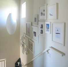 Hanging pictures by stairs - need to do this