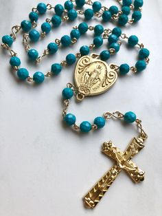 Handmade rosary with Chinese Turquoise gemstone beads, gold filled wire, and plated Miraculous Medal center. Design your own custom rosary from a selection of gemstone beads and various metals. Garnet Gemstone, Turquoise Gemstone, Gemstone Beads, Amethyst, Catholic Jewelry, Rosary Catholic, Indian Agate, Red Tigers Eye, Snowflake Obsidian