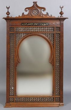 An antique Syrian mirror having stepped cornice with star decorated cartouche flanked by finials circa Elaborat. on Jun 2012 Turkish Furniture, Mirror Photo Frames, Wall Mirror, Moroccan Mirror, Trumeau, Wooden Arch, Pooja Room Design, Pooja Rooms, Indian Homes