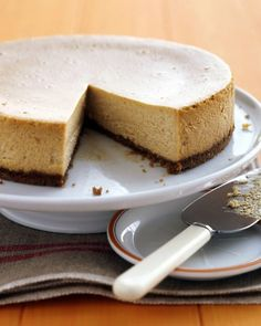Pumpkin Cheesecake by marthastewart: Two popular favorites -- pumpkin pie and cheesecake -- are rolled into one delightful dessert. Cheesecake keeps well in the refrigerator for several days, and it also freezes nicely. To thaw, simply place it in the refrigerator 24 hours before you wish to serve it. #Cheesecake #Pumpkin #Make_Ahead