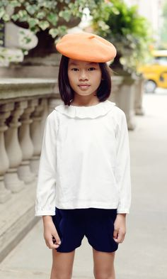 A bright beret makes makes this little fashionista stand out in a crowd.