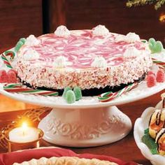 """Candy Cane Cheesecake Recipe -This pepperminty cheesecake says """"Christmas"""" at first sight and first bite. The recipe earned me a dairy producer's scholarship. Now, it regularly wins compliments at seasonal parties and teas."""