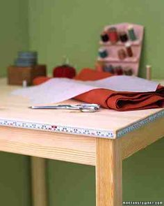 Quick Measuring Table - Make mending (and sewing projects) a snap by adhering measuring tape to the edge of your work table.