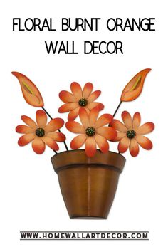 Easily spruce up your spring home decor with this pretty burnt orange floral wall decor piece.