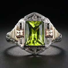 A bright lime green emerald-cut peridot glistens from within a highly distinctive, architecturally inspired Art Deco ring, die-struck and hand finished in tri-color (white, yellow and rose) gold - circa A beautiful and colorful vintage bauble. Art Deco Ring, Art Deco Jewelry, Jewelry Design, Jewelry Ideas, Edwardian Jewelry, Vintage Jewelry, Vintage Rings, Antique Jewelry, Peridot Jewelry