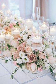 wedding centerpieces pink with spring flowers and roses and candles love theory #weddingflowers