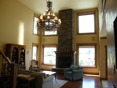 Stone Fireplace and Rustic Chandelier - 3772 Last Best Place Missoula Montana
