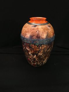 "Desert Urn - By David J Marks  is the title of this 81/2"" tall x 51/2"" diameter. It combines silver inlay into the pernambuco and ebony rim at the top. I gilded the lower body of the vessel with silver leaf and did a patina finish over it."