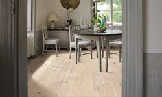 Kahrs Founders Hardwood Flooring Collection, white oak wide plank with warm tones, featuring a vintage look and rustic grain. Laminate Flooring, Hardwood Floors, Kahrs Flooring, Wide Plank, White Oak, Ground Floor, Dining Bench, Lounge, Indoor