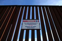 Trump's first 100 days:    A Donald Trump for President campaign sticker is shown attached to a U.S. Customs sign hanging on the border fence between Mexico  and the United States near Calexico, California.
