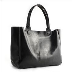 Rib & Hull Heirloom Tote Black Still smells like leather because I only used it a couple times. Love the soft leather. And the roominess of the bag. Rib & Hull Bags Totes