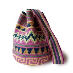 $49.90-$52.90 #Wayuubags. These double thread small mochila bag are perfect for carrying around a few items such as your phone, wallet and a few other necessities. They also make a very cute gift for younger women and young girls. The colors of these mochilas Wayuu are inspired by the vivid colors that surround region of La Guajira. All Wayuu bags come with a handwritten postcard, and little gift. The time required to elaborate a Wayuu Mochila varies from 4-7 days. www.lombiaandco.com Tapestry Bag, Tapestry Crochet, Gifts For Young Women, Phone Wallet, Little Gifts, Cute Gifts, Couture Fashion, Vivid Colors, Bucket Bag