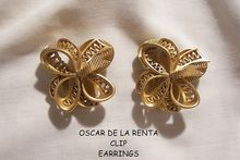 Aprils always something exciting in store sale Many items from 10-60% off Fabulous Oscar de La Renta Clip Bow Earrings
