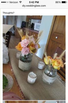 Cat tails and wheat arranged in mason jars